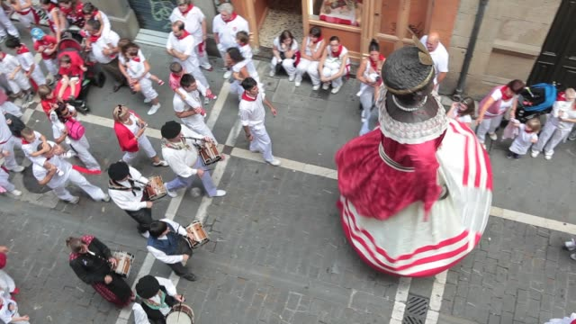 bigheaded figures dance surrounded by the crowd during the san fermin precession in pamplona navarra on july 7 2012 fiesta de san fermin 2012 on july... - comunidad foral de navarra stock videos and b-roll footage