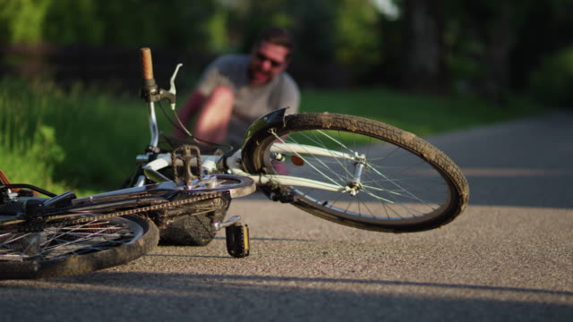 a bike accident. - falling stock videos & royalty-free footage
