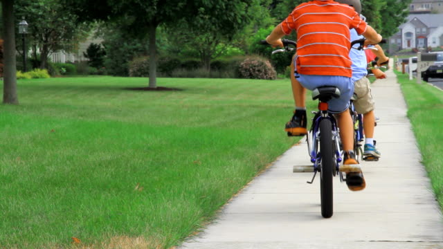 bike along grassy yard - suburban stock videos and b-roll footage