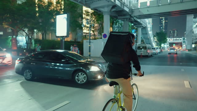 bike delivery person on the move through the city night. - indian ethnicity stock videos & royalty-free footage