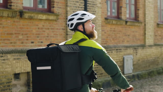a bike delivery person on the move through the city - delivering stock videos & royalty-free footage