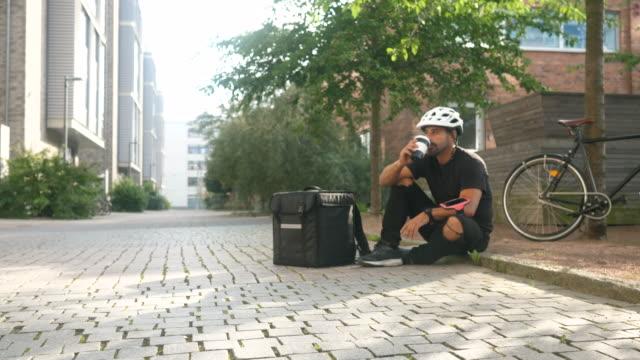 bike delivery taking a break - cycling helmet stock videos & royalty-free footage