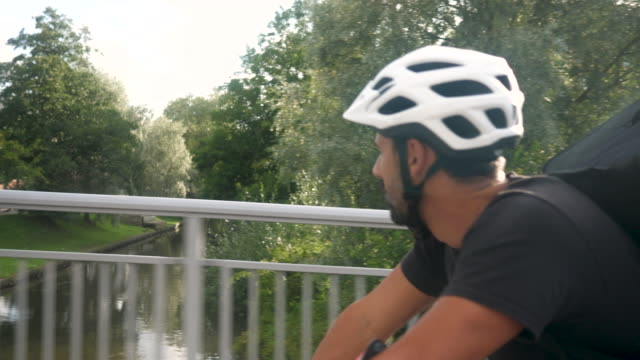 bike delivery - cycling helmet stock videos & royalty-free footage