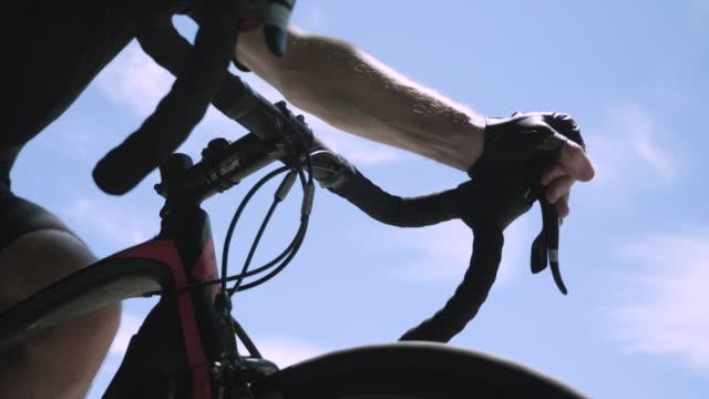 bike handlebars as senior cyclist climbs remote mountain road near mt. wilson california - struggle stock videos & royalty-free footage