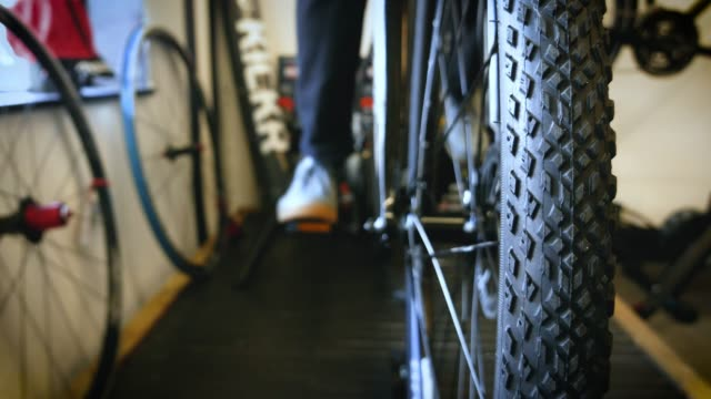 bike is pedaled on indoor turbo trainer - pedal stock videos & royalty-free footage