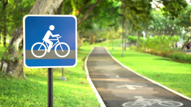 bike lane in public park - natural parkland stock videos & royalty-free footage