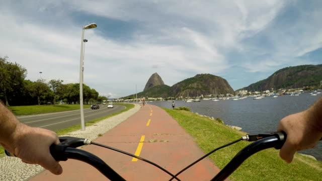 vídeos de stock, filmes e b-roll de ciclovia no rio de janeiro - bicicleta