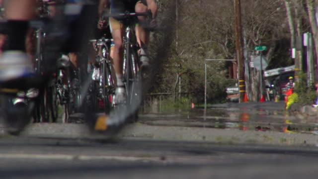 bike racers approaching left turn - racing bicycle stock videos & royalty-free footage