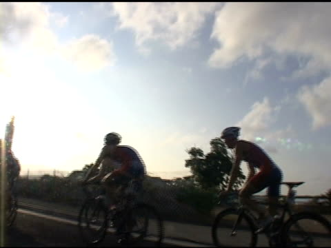 bike racers cyclist to sunburst bike racers in 2009 honolulu triathlon to sunburst on january 01 2012 - salmini stock videos & royalty-free footage
