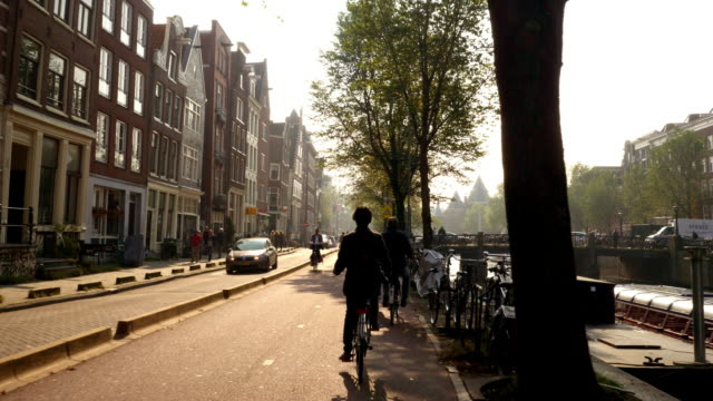 bike rider in amsterdam - amsterdam stock videos & royalty-free footage