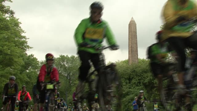 bike riders in cycling tour of nyc ride through central park - salmini stock videos & royalty-free footage