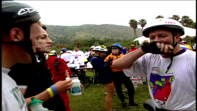 pov of bike riders talking and eating bananas and fiber bars malibu california - 1995 stock-videos und b-roll-filmmaterial