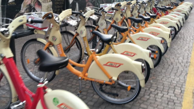 bike share loan bicycles in a line in europe. - transportation video stock e b–roll