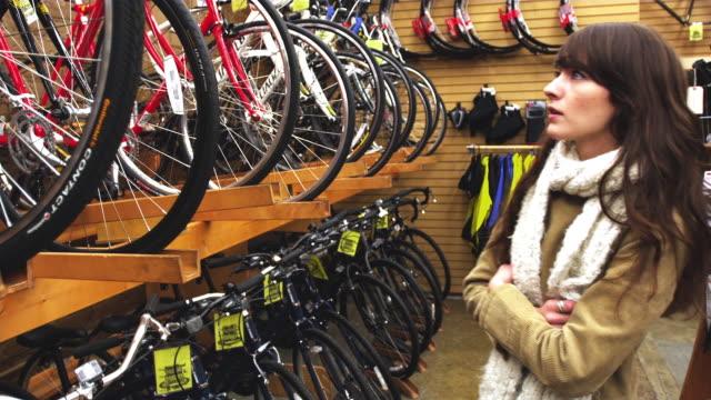 ms bike shop female customer shopping for bike / portland, oregon, usa - portland oregon bike stock videos & royalty-free footage