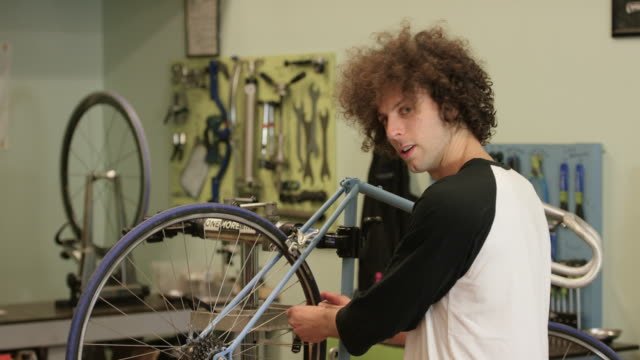 bike shop owner - fatcamera stock videos & royalty-free footage