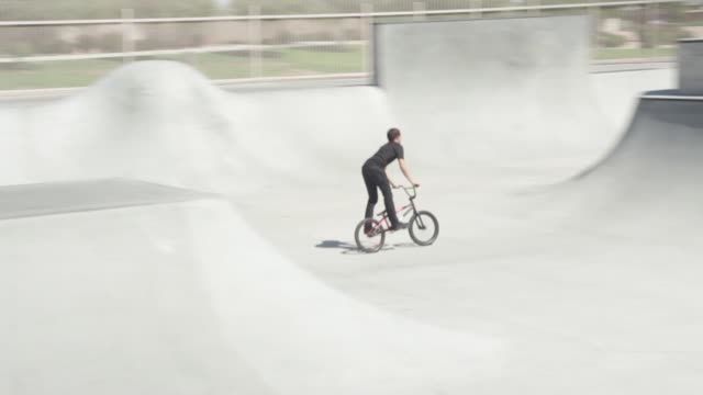 BMX bike tricks in a skate park