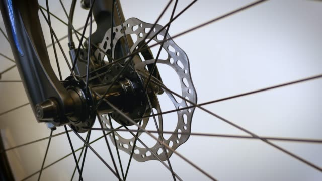 bike wheel spins in front of white background - cycling stock videos & royalty-free footage