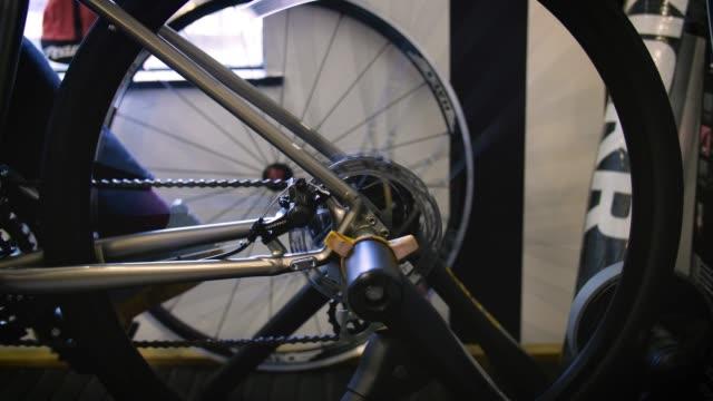 bike wheel spins on indoor turbo trainer - human limb stock videos & royalty-free footage