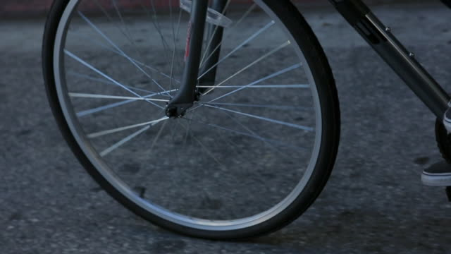 bike wheels on city streets - bicycle stock videos & royalty-free footage