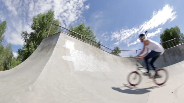 A BMX biker does a peg hop at a skate park in Idaho