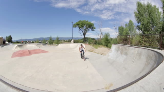 a bmx biker does a peg hop at a skate park in idaho - bmx cycling stock videos and b-roll footage