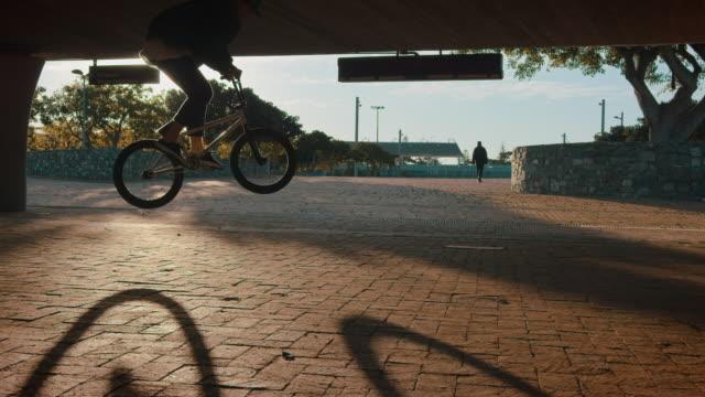 BMX biker driving around on a urban place