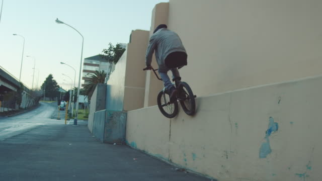 BMX biker driving in the streets