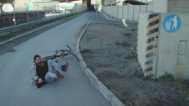 bmx biker driving in the streets - falling stock videos and b-roll footage