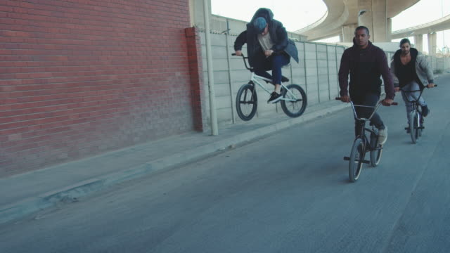 bmx biker driving in the streets - bmx cycling stock videos and b-roll footage