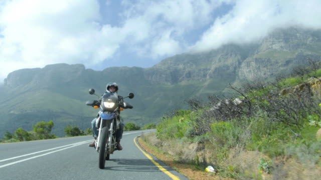 POV of biker driving towards camera along mountain pass/ Western Cape/ South Africa