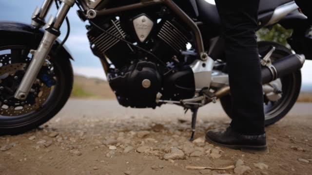 biker going towards his motorcycle - sports helmet stock videos & royalty-free footage