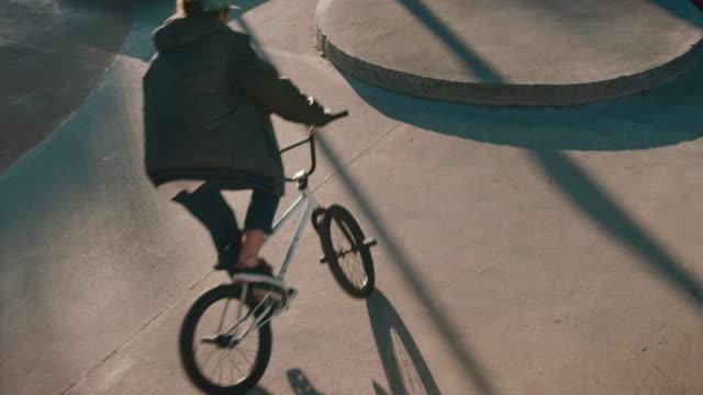 BMX biker jumping in bike park