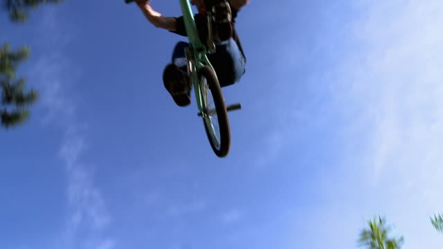 slo mo ws bmx biker jumping / jacksonville, florida, usa - freestyle bmx stock videos and b-roll footage
