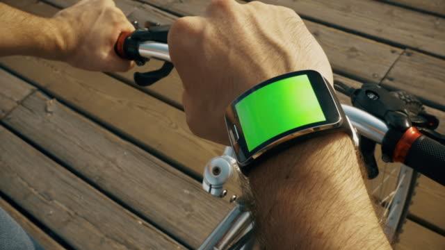 Biker looks his smartwatch