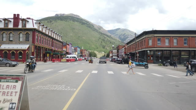 biker, ohv and people wearing mask crossing street in silverton, colorado, usa amid the 2020 coronavirus pandemic - colorado stock videos & royalty-free footage