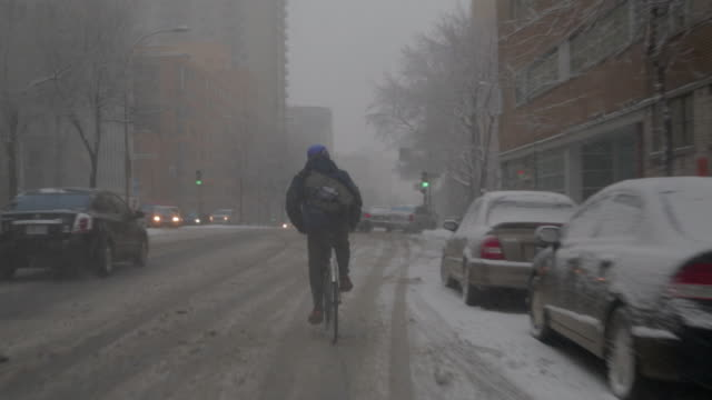 Biker pedaling in the snow