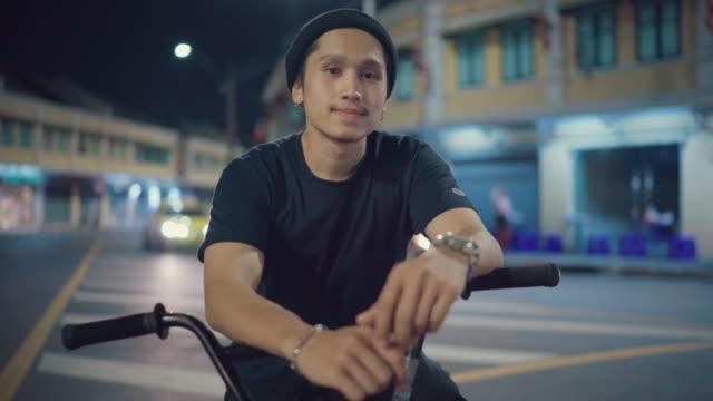 bmx biker posing for camera - filming stock videos & royalty-free footage