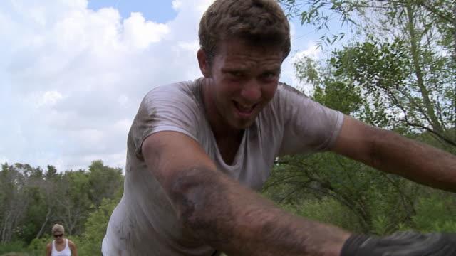 slo mo ws bmx biker pushing bike, smiling / jacksonville, florida, usa - making a face stock videos & royalty-free footage