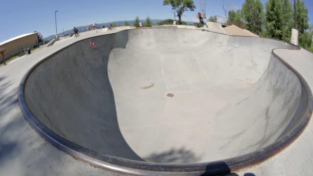 a bmx biker rides at a skate park in idaho - bmxに乗る点の映像素材/bロール