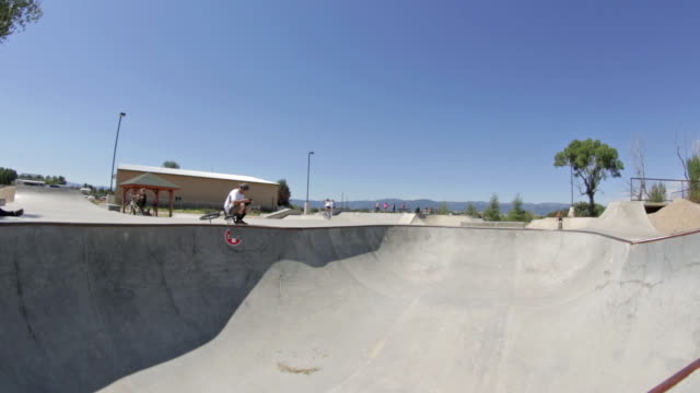 a bmx biker rides at a skate park in idaho - bmx cycling stock videos and b-roll footage