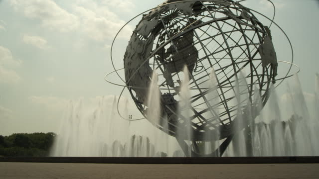 ms a biker rides in front of the unisphere at flushing meadows park in queens / new york city, new york - flushing meadows corona park stock videos and b-roll footage