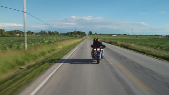 ws biker riding down country road with dog riding on back/ appleton, wisconsin - goatee stock videos & royalty-free footage