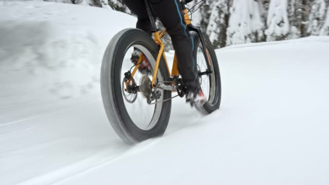 biker riding his fat bike on a trail covered in snow - riding stock videos & royalty-free footage