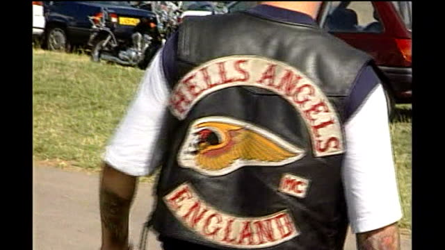 Police look for clues TX Warwickshire EXT Various shots of Hells Angels bikers at Bulldog Bash event in 1998 Skull image on bike hubcap Various flags...