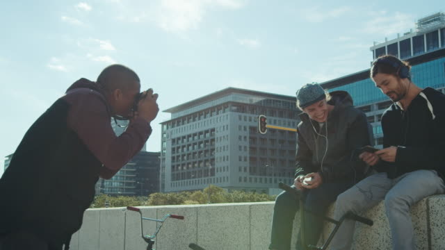 bmx biker taking pictures of each other - photo shooting stock videos and b-roll footage