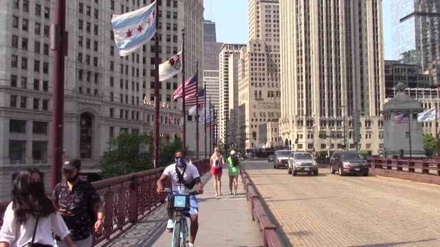 bikers and pedestrians cross the dusable bridge among general views of chicago, illinois on july 06 as major cities in the u.s. continue to adjust to... - dusable bridge stock videos & royalty-free footage