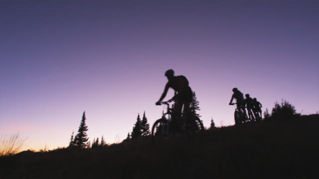 bikers at sunset - brighton ski area stock videos and b-roll footage