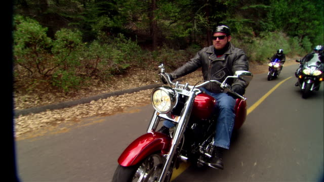 ws bikers driving motorcycles on curvy road near shaver lake in sierra national forest / fresno county, california, usa - motorcycle biker stock videos & royalty-free footage