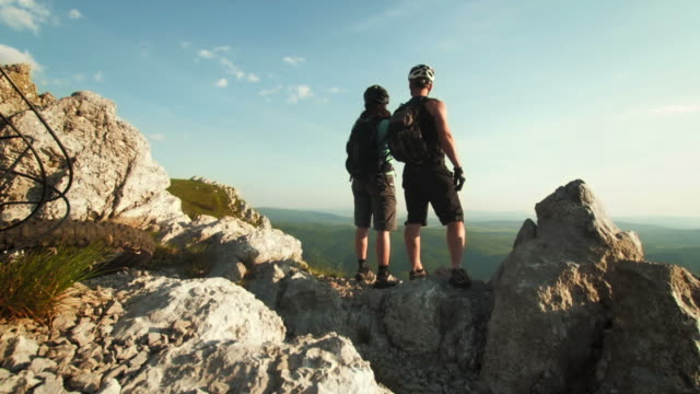 hd: bikers enjoying a view from the ridge - mountain biking stock videos & royalty-free footage