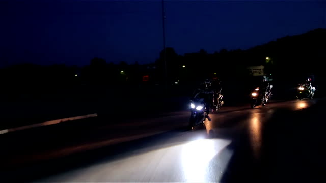 bikers race at night - motorcycle biker stock videos & royalty-free footage
